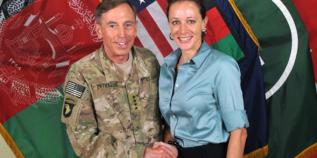 """July 13, 2011: Former Commander of International Security Assistance Force and U.S. Forces-Afghanistan Gen. Davis Petraeus, left, shakes hands with Paula Broadwell, co-author of his biography """"All In: The Education of General David Petraeus."""" (AP/ISAF)"""