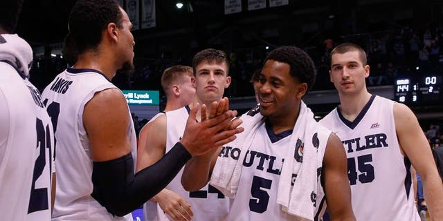 INDIANAPOLIS, IN - NOVEMBER 14: Jordan Gathers #5 of the Butler Bulldogs and members of the Butler Bulldogs celebrate an NCAA record for points scored after defeating Citadel 144-71 at Hinkle Fieldhouse on November 14, 2015 in Indianapolis, Indiana. (Photo by Michael Hickey/Getty Images)