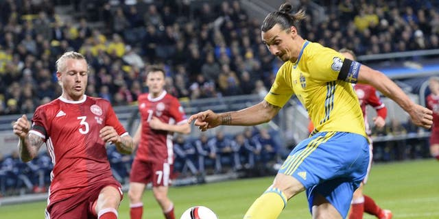 Denmark's defender Simon Kjaer (L) reacts as Sweden's forward and team captain Zlatan Ibrahimovic (r) shoots during the Euro 2016 play-off football match between Sweden and Denmark at the Friends arena in Solna on November 14, 2015. AFP PHOTO / JONATHAN NACKSTRAND (Photo credit should read JONATHAN NACKSTRAND/AFP/Getty Images)