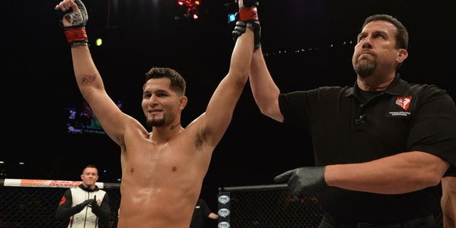 LAS VEGAS, NV - JULY 12: Jorge Masvidal reacts to his victory over Cezar Ferreira in their welterweight bout during the Ultimate Fighter Finale inside MGM Grand Garden Arena on July 12, 2015 in Las Vegas, Nevada. (Photo by Brandon Magnus/Zuffa LLC/Zuffa LLC via Getty Images)