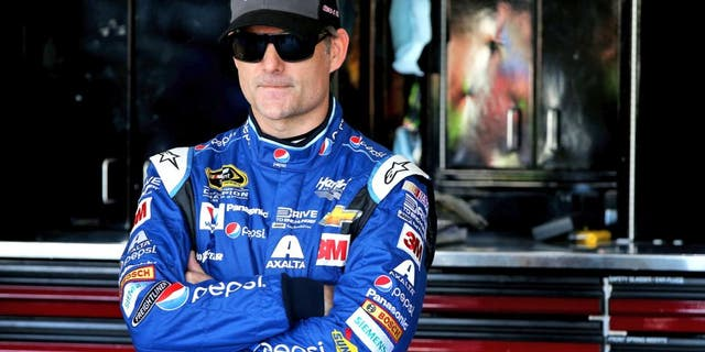 AVONDALE, AZ - NOVEMBER 14: Jeff Gordon, driver of the #24 Pepsi Chevrolet, stands in the garage area during practice for the NASCAR Sprint Cup Series Quicken Loans Race for Heroes 500 at Phoenix International Raceway on November 14, 2015 in Avondale, Arizona. (Photo by Sean Gardner/Getty Images)