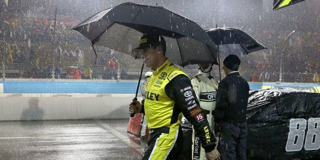 AVONDALE, AZ - NOVEMBER 15: Carl Edwards, driver of the #19 Stanley Toyota, walks off pit road in the rain during the NASCAR Sprint Cup Series Quicken Loans Race for Heroes 500 at Phoenix International Raceway on November 15, 2015 in Avondale, Arizona. (Photo by Matt Sullivan/NASCAR via Getty Images)