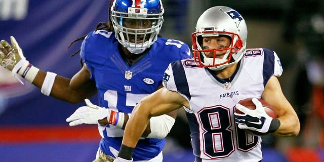 New England Patriots' Danny Amendola (80) runs away from New York Giants' Dwayne Harris (17) during the second half of an NFL football game Sunday, Nov. 15, 2015, in East Rutherford, N.J. (AP Photo/Gary Hershorn)
