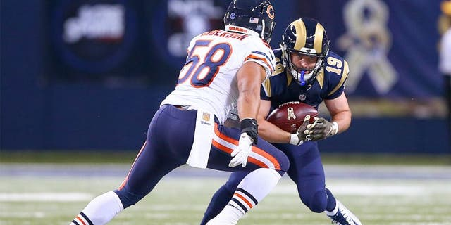 Nov 15, 2015; St. Louis, MO, USA; St. Louis Rams wide receiver Wes Welker (19) catches a pass for a first down as Chicago Bears outside linebacker Jonathan Anderson (58) closes in for the tackle during the second half at the Edward Jones Dome. The Bears won the game 37-13. Mandatory Credit: Billy Hurst-USA TODAY Sports