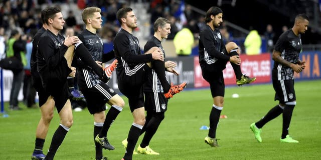 Germany's national football team warms up prior to a friendly international football match between France and Germany ahead of the Euro 2016, on November 13, 2015 at the Stade de France stadium in saint-Denis, north of Paris. AFP PHOTO / MIGUEL MEDINA (Photo credit should read MIGUEL MEDINA/AFP/Getty Images)