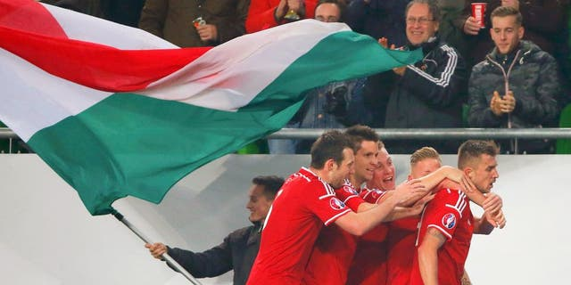 Football Soccer - Hungary vs Norway- UEFA EURO 2016 play-off - Grupama Arena 15/11/15. Hungary's Tamas Priskin (R) celebrates with teammates after scoring a goal. REUTERS/Laszlo Balogh Picture Supplied by Action Images