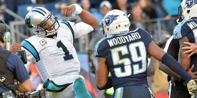 Nov 15, 2015; Nashville, TN, USA; Carolina Panthers quarterback Cam Newton (1) reacts in the end zone toward Tennessee Titans inside linebacker Wesley Woodyard (59) after scoring a touchdown during the second half at Nissan Stadium. Carolina won 27-10. Mandatory Credit: Jim Brown-USA TODAY Sports