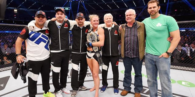 MELBOURNE, AUSTRALIA - NOVEMBER 15: Holly Holm celebrates with Team Holm after her second round KO (head kick and punches) against Ronda Rousey (not pictured) to win their UFC women's bantamweight championship bout during the UFC 193 event at Etihad Stadium on November 15, 2015 in Melbourne, Australia. (Photo by Josh Hedges/Zuffa LLC/Zuffa LLC via Getty Images)