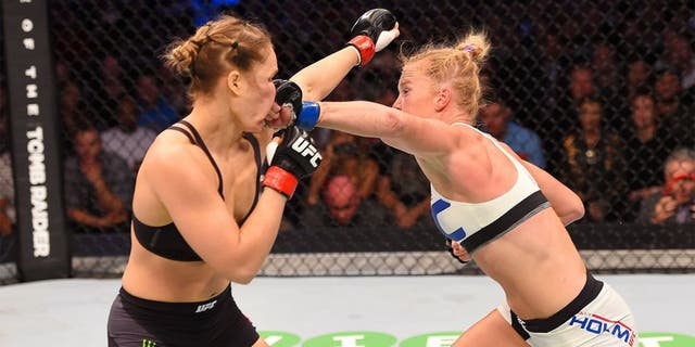 MELBOURNE, AUSTRALIA - NOVEMBER 15: Holly Holm (R) lands a punch against Ronda Rousey (L) in their UFC women's bantamweight championship bout during the UFC 193 event at Etihad Stadium on November 15, 2015 in Melbourne, Australia. (Photo by Josh Hedges/Zuffa LLC/Zuffa LLC via Getty Images)