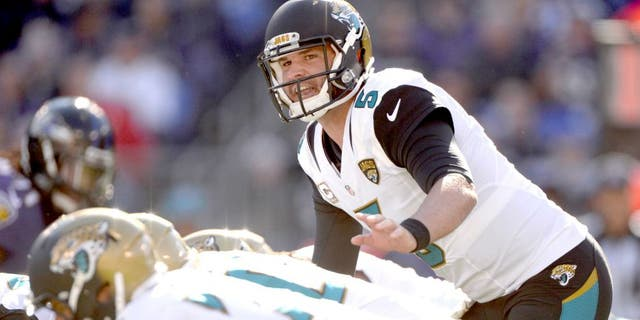 Nov 15, 2015; Baltimore, MD, USA; Jacksonville Jaguars quarterback Blake Bortles (5) calls a play at the line during the first quarter against the Baltimore Ravens at M&T Bank Stadium. Mandatory Credit: Tommy Gilligan-USA TODAY Sports