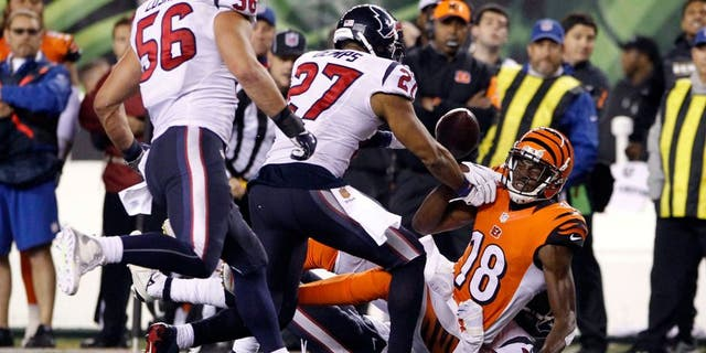 Nov 16, 2015; Cincinnati, OH, USA; Cincinnati Bengals wide receiver A.J. Green (18) fights for the ball with Houston Texans strong safety Quintin Demps (27) after fumbling the ball in the second half at Paul Brown Stadium. The Texans won 10-6. Mandatory Credit: Aaron Doster-USA TODAY Sports