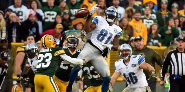 Nov 15, 2015; Green Bay, WI, USA; Green Bay Packers cornerback Damarious Randall (23) recovers an onside kick as the ball bounces off the hands of Detroit Lions wide receiver Calvin Johnson (81) in the fourth quarter at Lambeau Field. Mandatory Credit: Benny Sieu-USA TODAY Sports