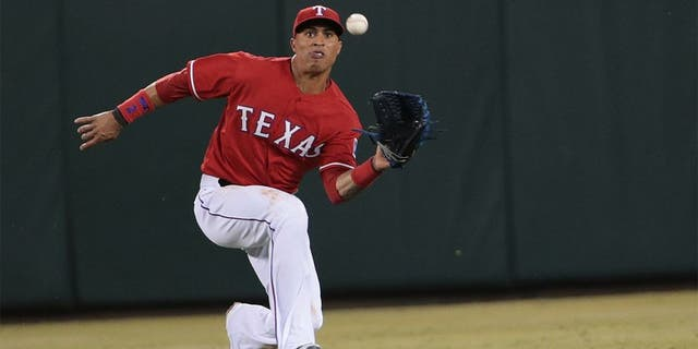 ARLINGTON, TX - SEPTEMBER 27: Leonys Martin #2 of the Texas Rangers makes a running catch hit by Alberto Callaspo of the Oakland Athletics in the seventh inning at Globe Life Park in Arlington on September 27, 2014 in Arlington, Texas. (Photo by Rick Yeatts/Getty Images)