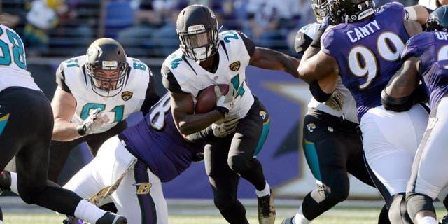 Nov 15, 2015; Baltimore, MD, USA; Jacksonville Jaguars running back T.J. Yeldon (24) runs during the first quarter against the Baltimore Ravens at M&T Bank Stadium. Mandatory Credit: Tommy Gilligan-USA TODAY Sports