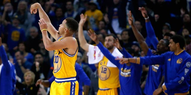 OAKLAND, CA - NOVEMBER 17: Stephen Curry #30 of the Golden State Warriors watches a three-point basket go in during their game against the Toronto Raptors at ORACLE Arena on November 17, 2015 in Oakland, California. NOTE TO USER: User expressly acknowledges and agrees that, by downloading and or using this photograph, User is consenting to the terms and conditions of the Getty Images License Agreement. (Photo by Ezra Shaw/Getty Images)
