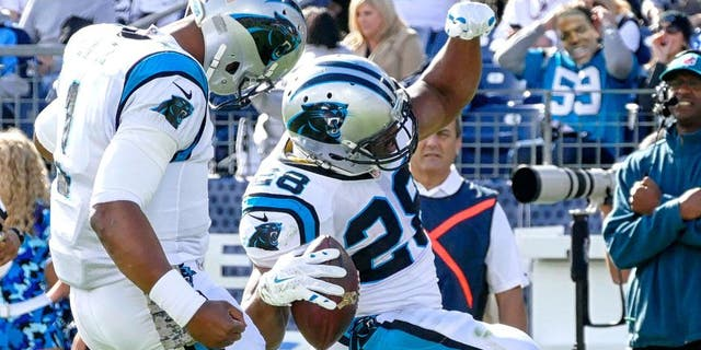 NASHVILLE, TN - NOVEMBER 15: Jonathan Stewart #28 of the Carolina Panthers celebrates with quarterback Cam Newton #1 after scoring a against the Tennessee Titans during the first half at Nissan Stadium on November 15, 2015 in Nashville, Tennessee. (Photo by Frederick Breedon/Getty Images)