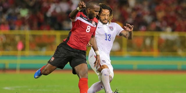 PORT OF SPAIN, TRINIDAD & TOBAGO - NOVEMBER 17: T&T's Khaleem Hyland battles to win the ball from USA's Jermaine Jones #13 during a World Cup Qualifier between Trinidad and Tobago and USA as part of the FIFA World Cup Qualifiers for Russia 2018 at Hasely Crawford Stadium on November 17, 2015 in Port of Spain, Trinidad & Tobago. (Photo by Ashley Allen Getty Images)