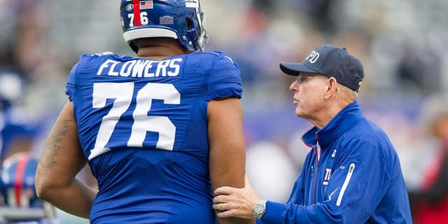 Oct 25, 2015; East Rutherford, NJ, USA; New York Giants head coach Tom Coughlin takes to offensive tackle Ereck Flowers (76) before the game against the Dallas Cowboys at MetLife Stadium. Mandatory Credit: William Hauser-USA TODAY Sports