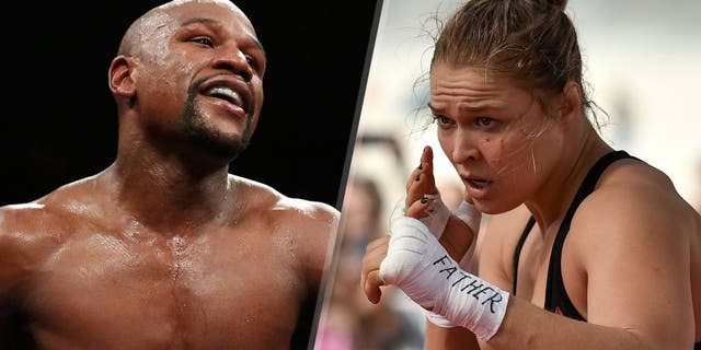 Floyd Mayweather Jr. walks in the ring during his WBC/WBA welterweight title fight against Andre Berto at MGM Grand Garden Arena on September 12, 2015 in Las Vegas, Nevada. (Photo by Ezra Shaw/Getty Images) Womens bantamweight champion Ronda Rousey of the United States holds an open training session at Pepe Beach on July 29, 2015 in Rio de Janeiro, Brazil. (Photo by Buda Mendes/Zuffa LLC/Zuffa LLC via Getty Images)