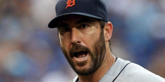 Jul 7, 2016; Toronto, Ontario, CAN; Detroit Tigers starting pitcher Justin Verlander (35) exchanges word with a teammate in the second inning during MLB game action against the Toronto Blue Jays at Rogers Centre. Blue Jays won 5-4.Mandatory Credit: Kevin Sousa-USA TODAY Sports