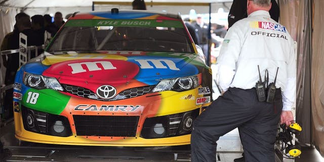 MARTINSVILLE, VA - MARCH 28: The #18 M&M's Toyota, driven by Kyle Busch, goes through technical inspection during qualifying for the NASCAR Sprint Cup Series STP 500 at Martinsville Speedway on March 28, 2014 in Martinsville, Virginia. (Photo by Jeff Curry/Getty Images)