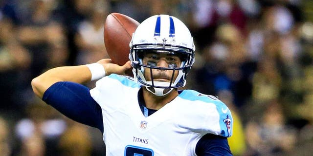 Nov 8, 2015; New Orleans, LA, USA; Tennessee Titans quarterback Marcus Mariota (8) against the New Orleans Saints during the second half of a game at the Mercedes-Benz Superdome. The Titans defeated the Saints 34-28 in overtime. Mandatory Credit: Derick E. Hingle-USA TODAY Sports