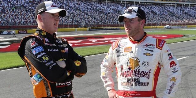 CHARLOTTE, NC - MAY 23: Ty Dillon, driver of the #3 Bass Pro Shops/NWTF.org Chevrolet, talks to Regan Smith, driver of the #7 Anderson's Pure Maple Syrup Chevrolet, on the grid after the NASCAR XFINITY Series Hisense 300 at Charlotte Motor Speedway on May 23, 2015 in Charlotte, North Carolina. (Photo by Jerry Markland/Getty Images)