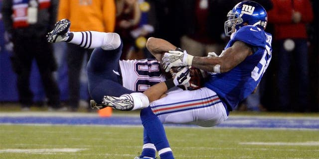 Nov 15, 2015; East Rutherford, NJ, USA; New England Patriots wide receiver Danny Amendola (80) catches a pass against New York Giants outside linebacker Jonathan Casillas (54) during the game at MetLife Stadium. Mandatory Credit: Robert Deutsch-USA TODAY Sports
