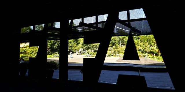 The FIFA logo made with mirrors is pictured at the FIFA headquarters on June 3, 2015 in Zurich. Blatter on June 2, 2015 resigned as president of FIFA as a mounting corruption scandal engulfed world football's governing body. The 79-year-old Swiss official, FIFA president for 17 years and only reelected on May 29, said a special congress would be called as soon as possible to elect a successor. AFP PHOTO / MICHAEL BUHOLZER (Photo credit should read MICHAEL BUHOLZER/AFP/Getty Images)