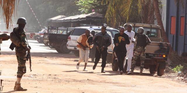 Nov. 20, 2015: People run to flee from the Radisson Blu Hotel in Bamako, Mali.