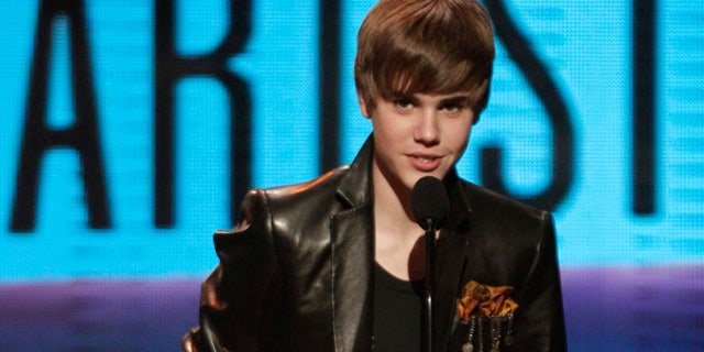 Nov. 21: Justin Bieber accepts the award for pop/rock favorite male artist at the American Music Awards in Los Angeles.