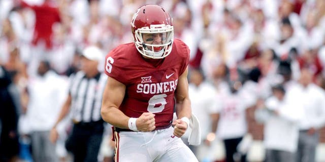 Oct 24, 2015; Norman, OK, USA; Oklahoma Sooners quarterback Baker Mayfield (6) celebrates after a touchdown pass against the Texas Tech Red Raiders during the third quarter at Gaylord Family - Oklahoma Memorial Stadium. Mandatory Credit: Mark D. Smith-USA TODAY Sports