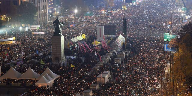 Nov. 19, 2016: Tens of thousands of South Korean protesters stage a rally calling for South Korean President Park Geun-hye to step down in Seoul, South Korea.
