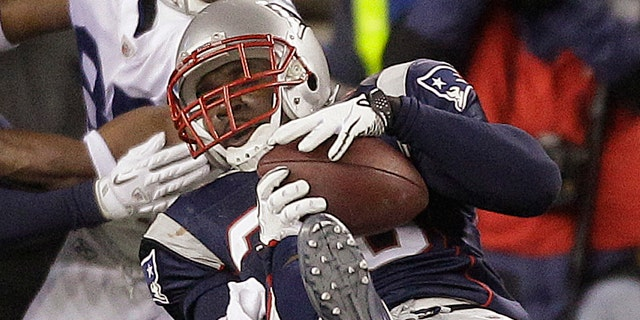 Nov. 21: New England Patriots safety James Sanders (36) intercepts Indianapolis Colts quarterback Peyton Manning pass during the waning seconds of the fourth quarter of their NFL football game in Foxborough, Mass.