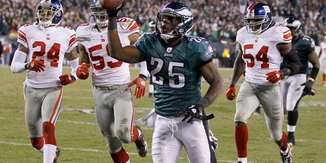 Nov. 21: Philadelphia Eagles running back LeSean McCoy carries the ball to the goal line for a touchdown during the second half of an NFL football game against the New York Giants in Philadelphia.