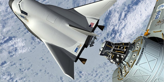 This artist's rendering provided by Sierra Nevada Space Systems shows the company's Dream Chaser spacecraft docking with the International Space Station.