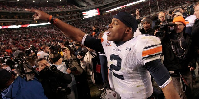 Nov. 26: Auburn quarterback Cameron Newton celebrates after their 28-27 win over Alabama in an NCAA college football game at Bryant-Denny Stadium in Tuscaloosa, Ala.