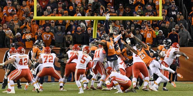 DENVER, CO - NOVEMBER 27: Kansas City Chiefs kicker Cairo Santos (5) kicks the winning field goal in overtime against the Denver Broncos November 27, 2016 at Sports Authority Field at Mile High Stadium. Kansas City Chiefs defeated the Denver Broncos 30-27 for the overtime win. (Photo By John Leyba/The Denver Post via Getty Images)