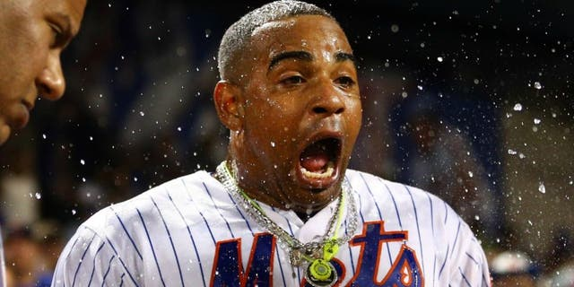 Aug 29, 2016; New York City, NY, USA; New York Mets left fielder Yoenis Cespedes (52) reacts after being doused by Mets second baseman Wilmer Flores (not pictured) during his post game interview after hitting a walk off solo home run against the Miami Marlins during the tenth inning at Citi Field. Mandatory Credit: Brad Penner-USA TODAY Sports