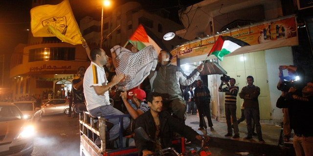 Nov. 21, 2012: Palestinians celebrate the cease-fire agreement between Israel and Hamas in Gaza City.