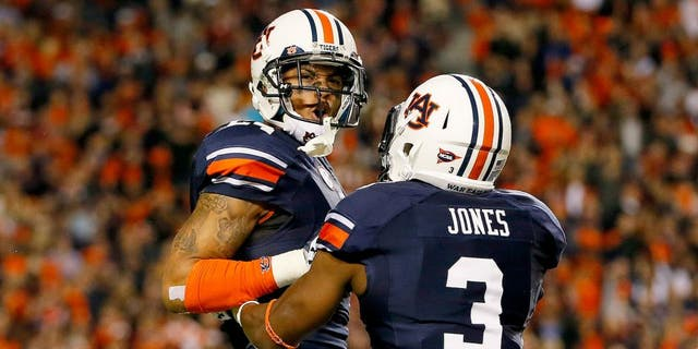 AUBURN, AL - NOVEMBER 30: Ryan Smith #24 of the Auburn Tigers yells to an official as he and Jonathan Jones #3 react after Smith recovered a blocked punt in the fourth quarter against the Alabama Crimson Tide at Jordan-Hare Stadium on November 30, 2013 in Auburn, Alabama. (Photo by Kevin C. Cox/Getty Images)