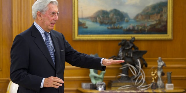 Mario Vargas Llosa poses for the photographers at the Zarzuela Palace on May 11, 2011 in Madrid, Spain.
