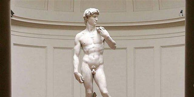 """Michelangelo's marble statue of """"David"""", is seen in  Florence's Galleria dell' Accademia in this Monday, May 24, 2004 file photo."""