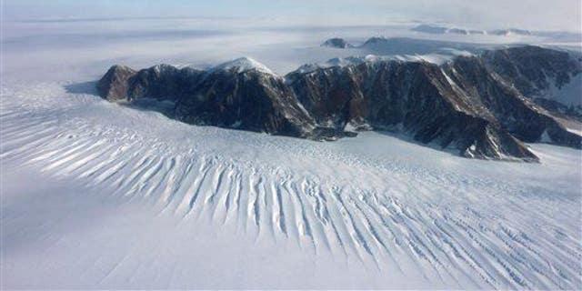 In this photo taken on Nov. 25, 2011, a plane flies over the Transantarctic Mountains.