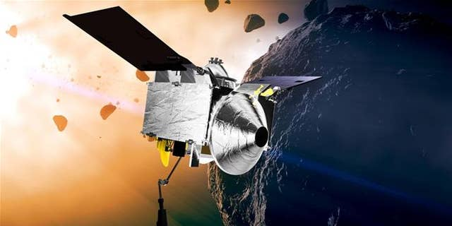 This illustration provided by NASA depicts the OSIRIS-REx spacecraft at the asteroid Bennu.