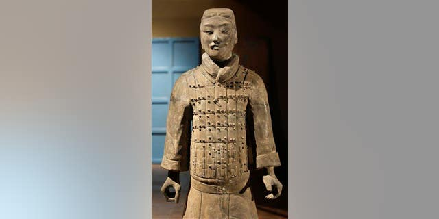 """A terra cotta statue is unpacked for the exhibition """"Terra Cotta Warriors: Guardians of China's First Emperor,"""" at the Bowers Museum in Santa Ana, Calif., in this file photo."""