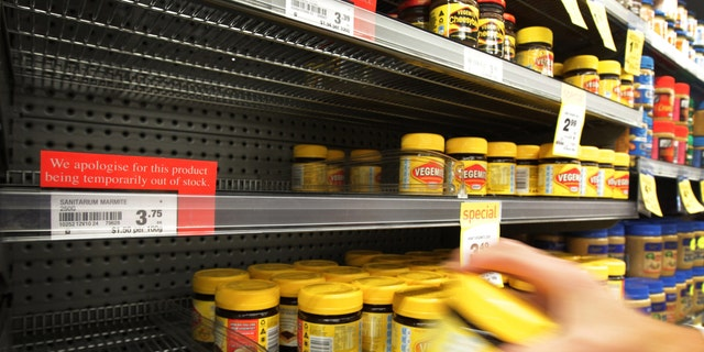 March 20, 2012: A customer takes a jar of Vegemite from next to an empty shelve where Marmite should be stocked in a supermarket in Auckland, New Zealand.