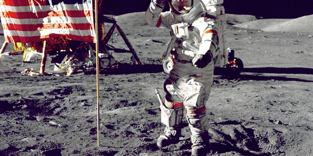Eugene Cernan salutes the American flag during the Apollo 17 mission in 1972.