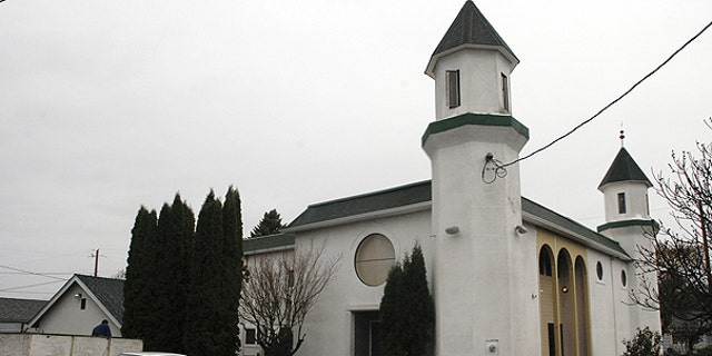 Nov. 30: The Salman Alfarisi Islamic Center stands in Corvallis, Ore., where members cleaned up debris from a fire apparently triggered by the arrest of a 19-year-old former Oregon State University student on charges he tried to set off a car bomb at a Christmas tree lighting ceremony in Portland.