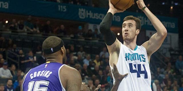 Nov 23, 2015; Charlotte, NC, USA; Charlotte Hornets center Frank Kaminsky III (44) goes up for a shot over Sacramento Kings guard Darren Collison (7) during the second half at Time Warner Cable Arena. The Hornets defeated the Kings 127-122 in OT. Mandatory Credit: Jeremy Brevard-USA TODAY Sports